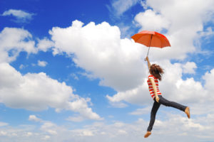 leaping in the sky with umbrella