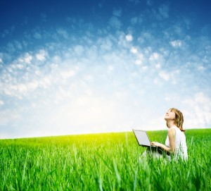 thoughtful with laptop in field