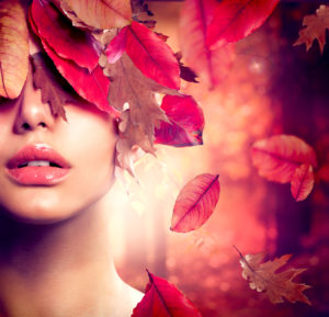 serious woman and red leaves